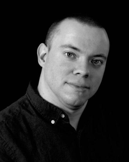 Head Shot of Adam Warren